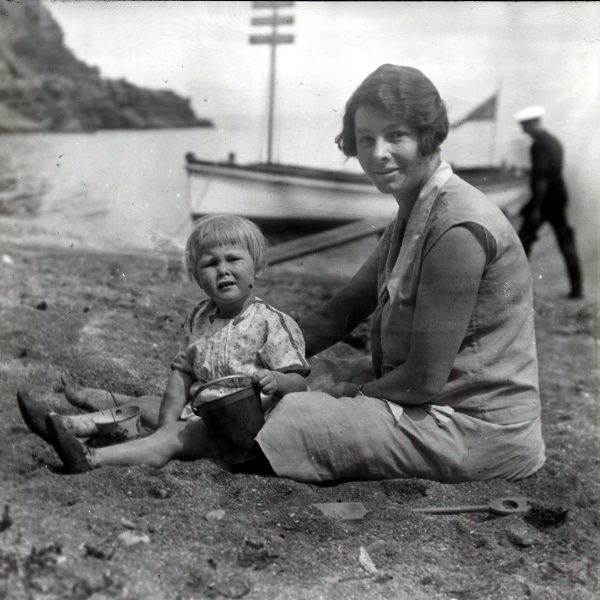 Norah with child on beach